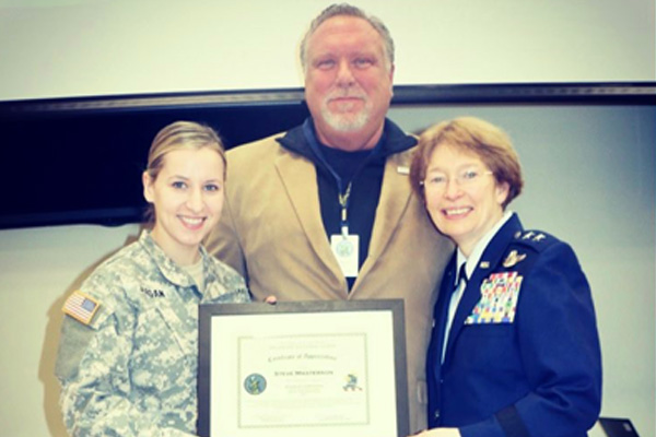 STEVE MASTERSON ACCEPTING HONORARY COMMANDER PLAQUE
